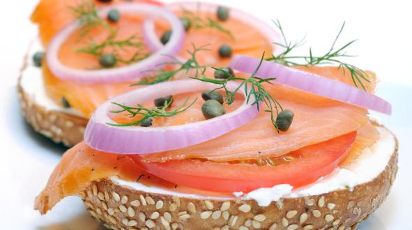 Smoked salmon with red onion and capers on a sesame bagel